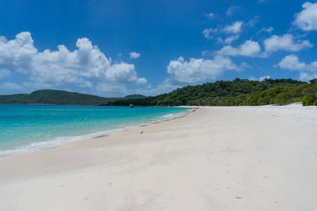 whitehaven beach: Shoreline of tropical island beach. Summer vacation background. Summer vacation background. Tropical paradise getaway scene Stock Photo