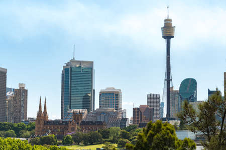 Sydney cityscape with St Marys Cathedral and Sydney Tower on sunny day