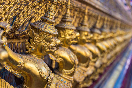 Garuda decoration on Grand Palace, Bangkok, Thailand. The statues of Krut battling naga serpent. Asian mythology scene