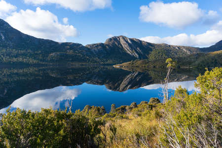 Mountain range landscape reflected in water. Cradle Mountain - St Claire National Park, Tasmania, Australia Stock Photo