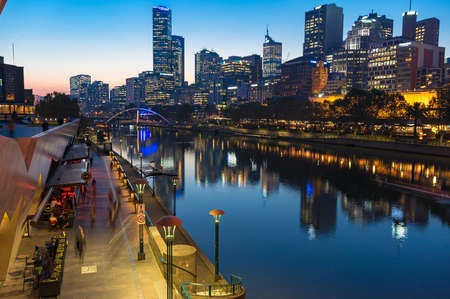 southgate: Melbourne, Australia - April 18, 2017: Southbank Promenade and Melbourne CBD view at night. Southbank is inner neighbourhood of Melbourne, Australia