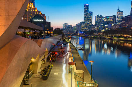 southgate: Melbourne, Australia - April 18, 2017: Southbank Promenade and Yarra river embankment at night. Southbank is inner neighbourhood of Melbourne, Australia