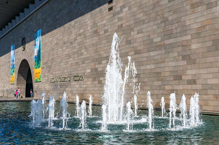 Melbourne, Australia - April 18, 2017: National Gallery of Victoria fountain with gallery entrance on the background