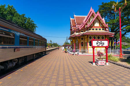 Hua Hin, Thailand - December 26, 2015: Hua Hin railway station platform with view of arriving train