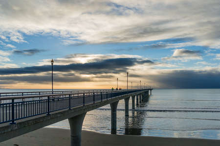 New Brighton pier on sunrise with dramatic clouds. Christchurch, New Zealand 写真素材