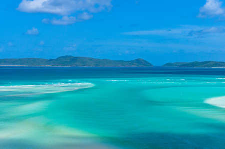 Amazing tropical seascape, landscape of turquoise blue lagoon and coral reef islands. Whitsunday, Queensland, Australia
