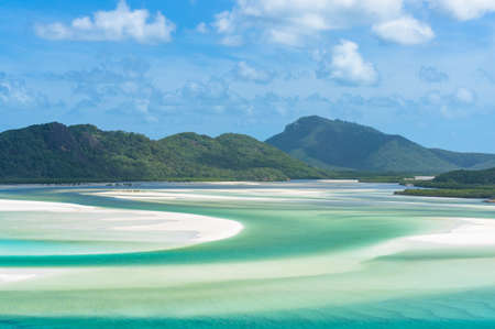 Panorama view of picturesque tropical lagoon with turquoise blue water and mountain on the background. Hill Inlet, Whitsundays, Queensland. Australia