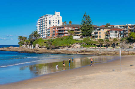 waterfront property: Sydney, Australia - May 24, 2017: People relaxing and sunbathing on Cronulla beach