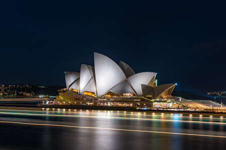Sydney, Australia - July 10, 2016: Sydney Opera House at night with ferry light trails over the water