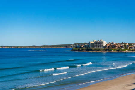 waterfront property: Ocean view landscape with beach, waterfront property and Royal National Park in the distance. Cronulla suburb, Sydney, Australia