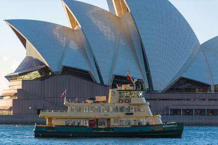 Sydney, Australia - July 23: Ferry boat in Circular Quay with Sydney Opera House on the background. Sydney public water transport infrastructure Editorial