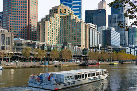 melba: Melbourne, Australia - April 20, 2017: Melba Star cruise boat on Yarra river with Melbourne cityscape on the background Editorial