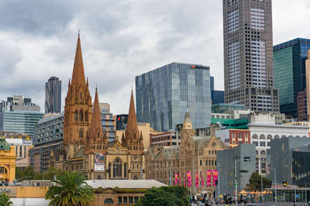 Melbourne, Australia - April 21, 2017: Melbourne CBD view with St Pauls cathedral building