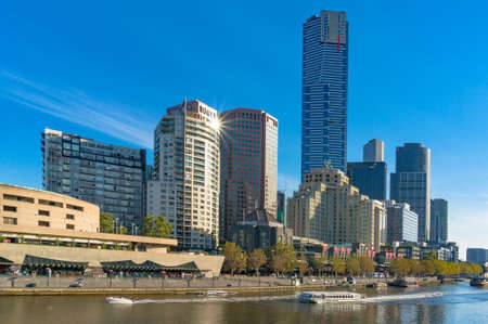 southgate: Melbourne, Australia - April 4, 2017: Beautiful Melbourne Southbank cityscape with river view and sun reflected on building window on bright sunny day