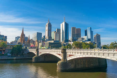 Melbourne, Australia - April 4, 2017: Melbourne CBD cityscape with Princess Bridge over Yarra river on bright sunny day. Beautiful urban landscape