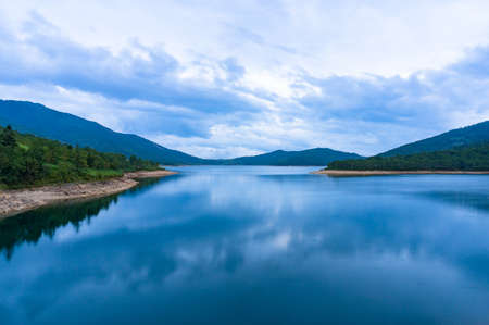 smooth: View from above on mountain lake at blue hour. Japanese nature landscape. Nozori lake, Japan