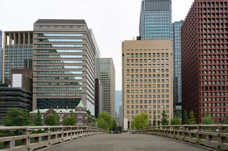 featureless: Cityscape with tall buildings and wide bridge, road. Marunouchi suburb, Tokyo, Japan Stock Photo