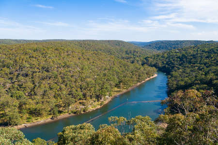 View from above on endless forest with beautiful river on clear day Stock Photo
