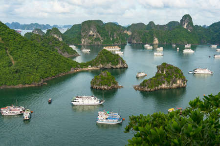 Halong bay mountain islands with cruise boats. View from above