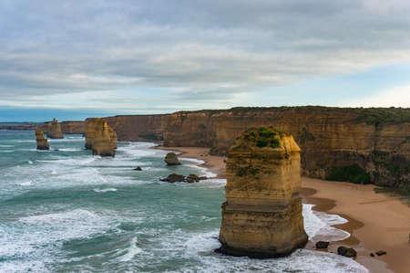 mare agitato: Twelve Apostles natural landmark along Great Ocean Road,. Popular tourist attraction and travel destination. Victoria, Australia