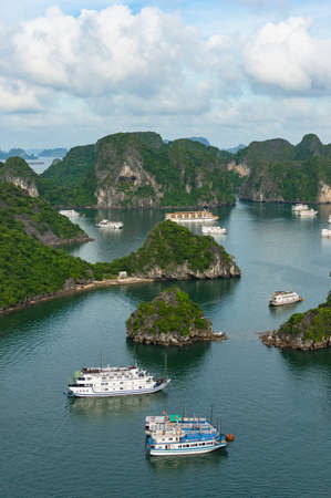 Aerial landscape of Halong bay mountain islands with cruise boats. View from above Stock Photo