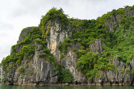 Impressive mountain island in Halong Bay, Vietnam. Nature wonders landscape