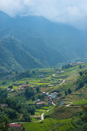 Spectacular view on mountain valley village with rice terraces. Vietnam