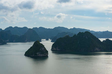 Halong bay mountain islands landscape at dusk. Ha Long Bay popular tourist attraction and tourism spot in Vietnam Stock Photo