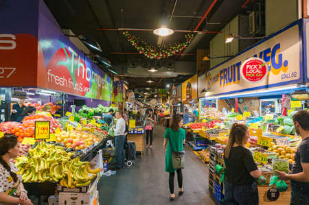 Adelaide, Australia - November 10, 2017: Adelaide Central Market with food stalls full of fresh fruits and vegetables