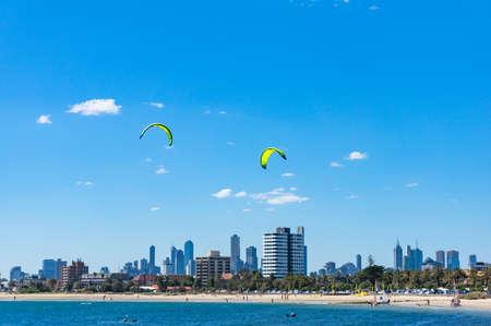 Picturesque Melbourne cityscape with kite surfers on St Kilda beach. Melbourne, Australia