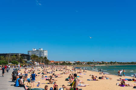 Melbourne, Australia - December 7, 2016: People relaxing and sunbathing in St.Kilda beach on sunny day Editorial