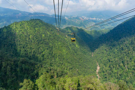 Sapa, Vietnam - Cable car to Fansipan mountain with aerial mountain landscape view on the background