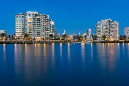 Port Melbourne waterfront apartment buildings at blue hour, dusk. Melbourne, Australia Stock Photo