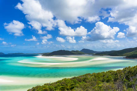 Tropical beach paradise background of turquoise blue water and Coral sea beach. Aerial Whitehaven beach and Hill inlet estuary