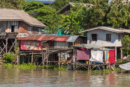 Ayutthaya, Thailand - January 1, 2016: Slums along the river in Auyutthaya