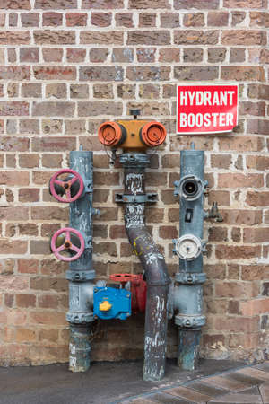 Hydrant booster construction with pipes, valves and taps