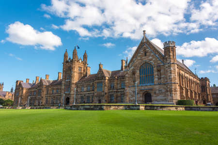 Sydney, Australia - April 25, 2016: University of Sydney gothic style facade with green grass lawn in front of building Editorial