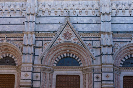 Siena Cathedral facade with ornate walls and windows, Italian historic architecture
