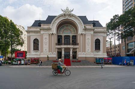 Ho Chi Minh City, Vietnam - August 24, 2017: City Opera House with hawker street vendor on scooter, Ho Cho Ming City, Saigon, VIetnam Editorial