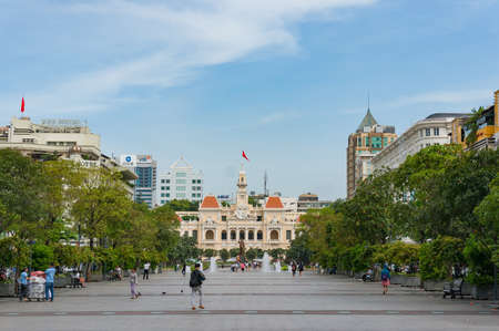 Ho Chi Minh City, Vietnam - August 24, 2017: Nguyen Hue street with Ho Chi MInh CIty Hall building view