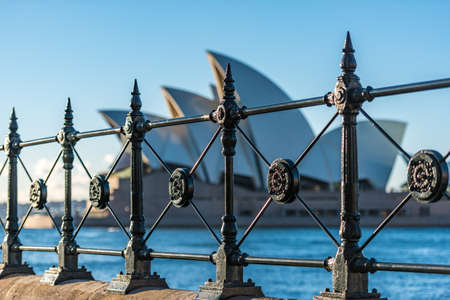 Sydney, Australia - July, 23, 2016: Cast iron fence decorations at Circular Quay with Sydney Opera House on the background Editorial