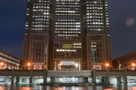 Tokyo, Japan - August 29, 2016: Tokyo MEtropolitan Government Building exterior with Tokyo Olympic signs. Long exposure night shot with lens flare