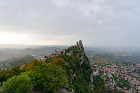 Aerial view of Guaita, First Tower on the cliff edge and City of San Marino with beautiful view on panoramic countryside landscape. Monte Titano, San Marino