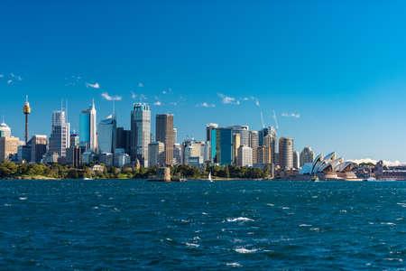 Sydney, Australia - July 23, 2016: Sydney CBD cityscape with iconic Sydney Opera House across Sydney Harbour Editorial