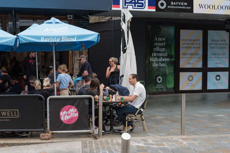 Sydney, Australia - April 14, 2019: People relaxing at outdoor cafe in Cronulla suburb of Sydney