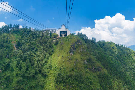 Cable car station on top of the mountain hill. Tourist adventure scene background Reklamní fotografie