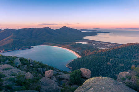 Sunrise landscape of beautiful bay and mountains. Wineglass bay in Freycinet National Park, Tasmania, Australia