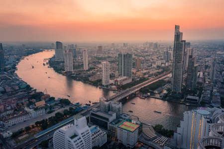 Bangkok cityscape at sunset. Birds eye view of urban sprawl with skyscrapers and hotels