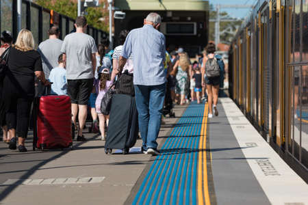 Sydney, Australia - April 21, 2019: Crowd of people alighting from the train in Sydney. Locals and tourists using Sydney public transport