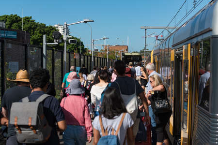 Sydney, Australia - April 21, 2019: People alighting from the train on Cronulla Station in Sydney